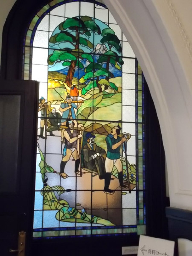 Stained Glass Depicting Old Transportation in Port Open Memorial Hall