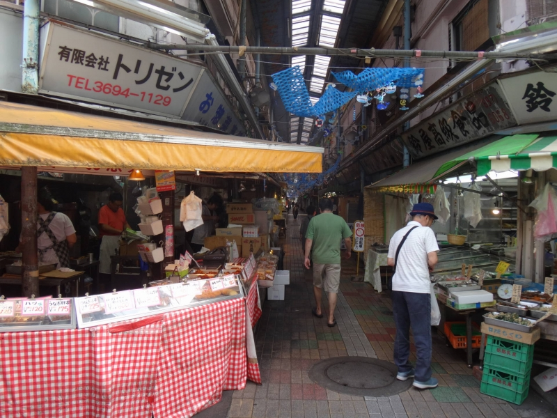 Locals gather to buy groceries in this back alley in Tateishi