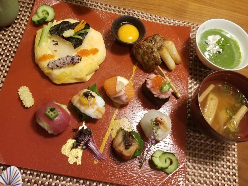 Original sushi, Temari-zushi, tsukune, miso soup, and sesame pudding with matcha sauce.