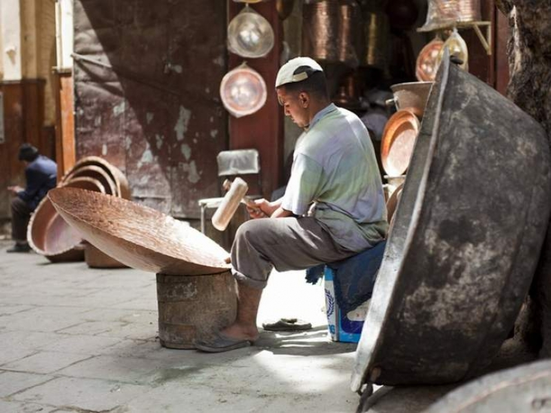 A craftman in his workshop in the souks