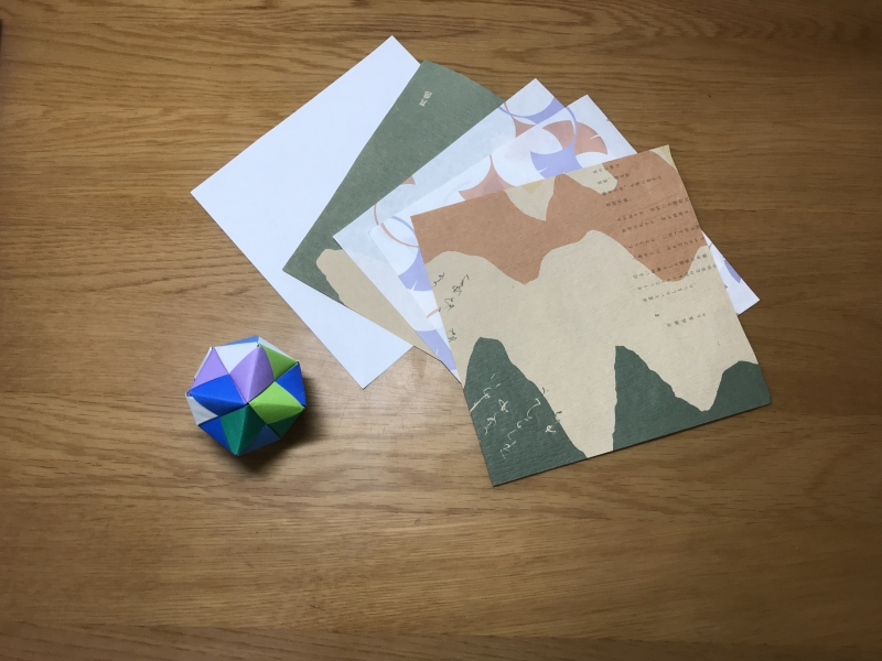 Origami sheets cut from regular size paper and wrapping paper.