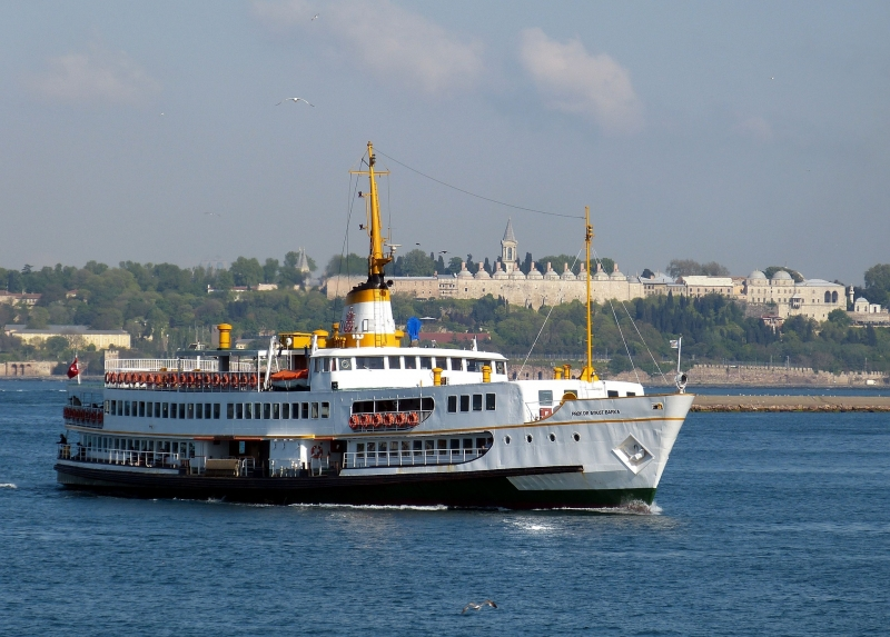 A public boat on Bosphorus. Topkapi Palace behind.