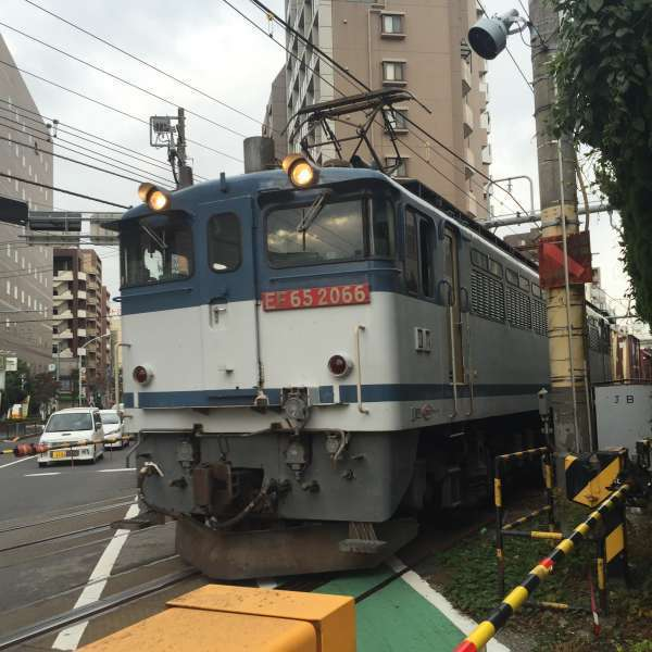 A freight train at the railroad crossing near Nippori station