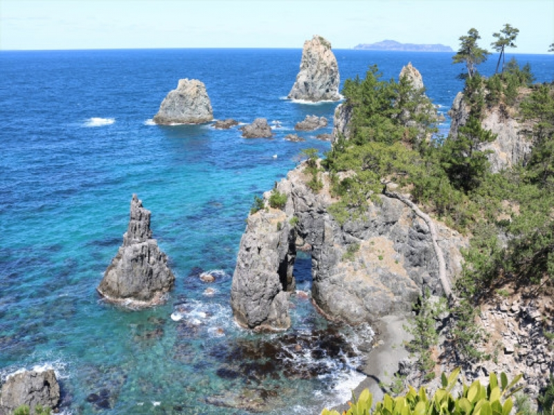 Caves and odd rock formations on a little island in the Sea of Japan.