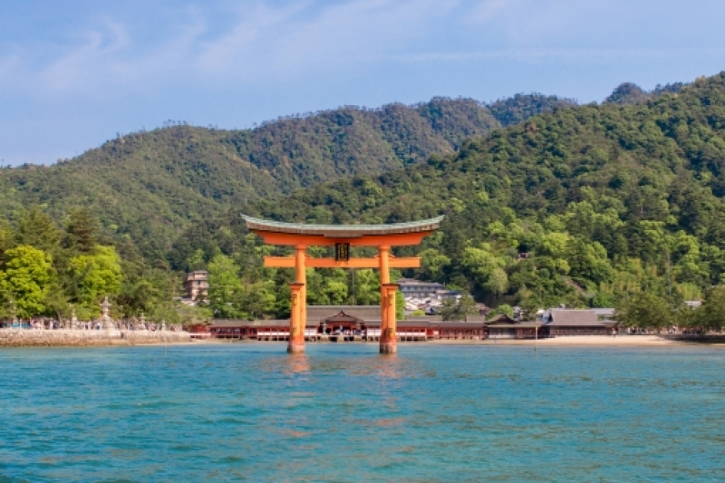 Miyajima (宮島) is a small island less than an hour outside the city of Hiroshima. It is most famous for its giant torii gate, which at high tide seems to float on the water. The sight is ranked as one of Japan's three best views.