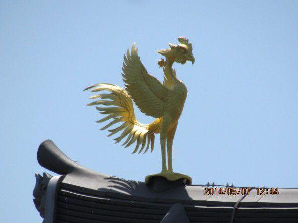 one of a pair of bronze phoenixes
