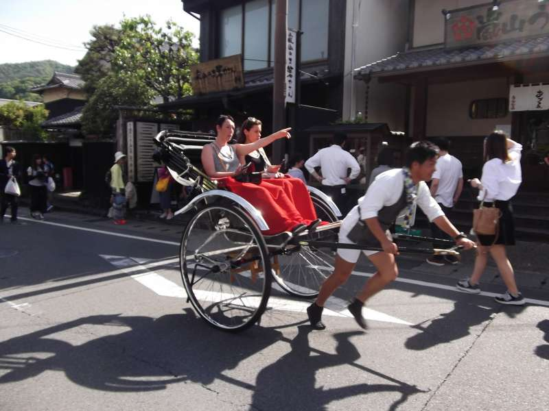 Rickshaw being towed by a young man, a special attraction of Arashiyama.