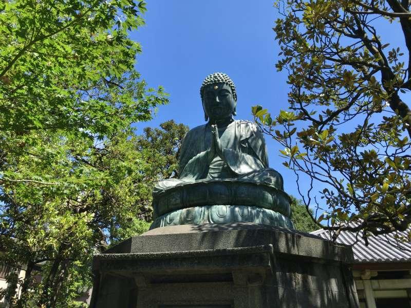 A Buddhist statue in Tenno-ji Temple in Yanaka.