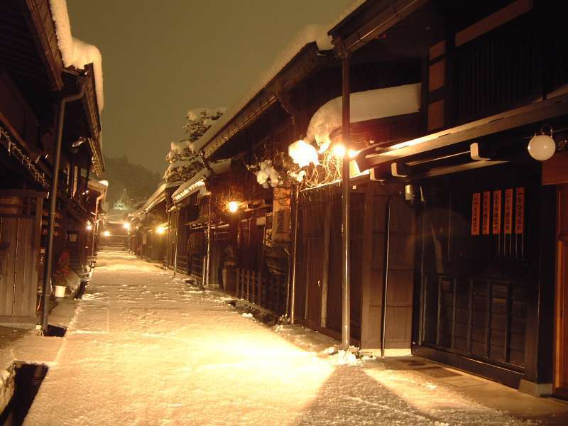 The tranquill view of Old Town Area in snow-night.
