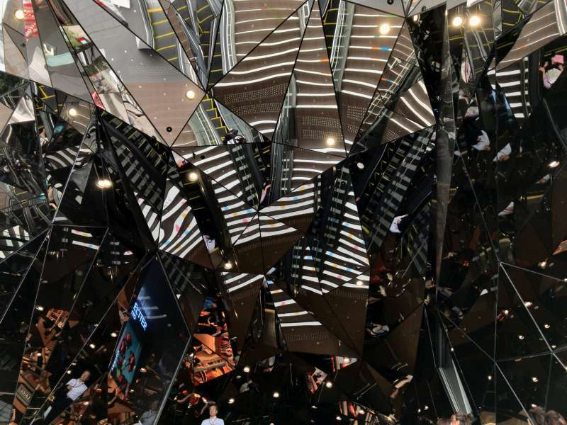 Like a kaleidoscope, a patchwork of mirrors surrounding escalators in TOKYU PLAZA OMOTESANDO HARAJUKU, in Harajuku area