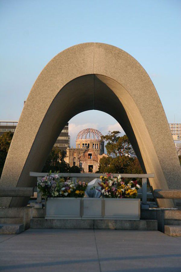 Near the center of the park is a concrete, saddle-shaped monument that covers a cenotaph holding the names of all of the people killed by the bomb. The monument is aligned to frame the Peace Flame and the A-Bomb Dome. The Memorial Cenotaph was one of the first memorial monuments built on open field on August 6, 1952. The arch shape represents a shelter for the souls of the victims