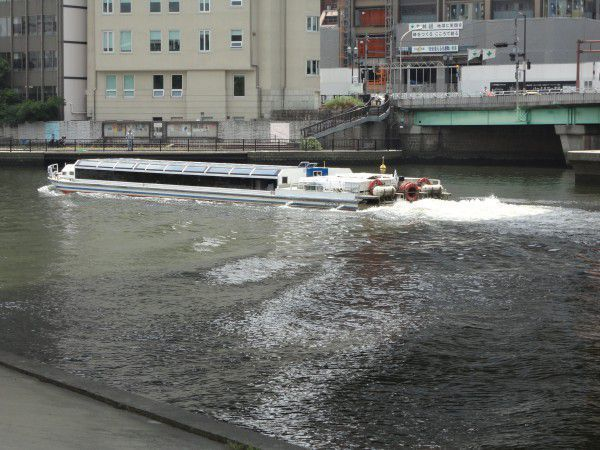 A aqua liner boat is cruising on Okawa river.