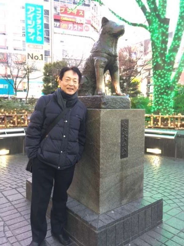 Faithful dog statue at square before JR Shibuya station.  The dog waited for his master every evening because it didn't know its master already passed away by accident. People are moved with its faithful mind.