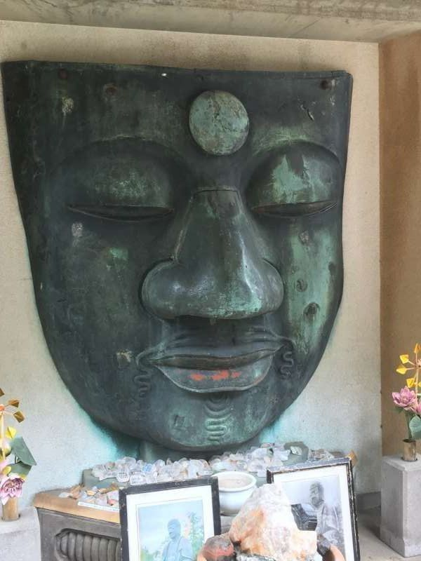 Only the part of face of a Buddhist image.  Buddhist image has been damaged by several disasters, consequently, the statue only retains its face.