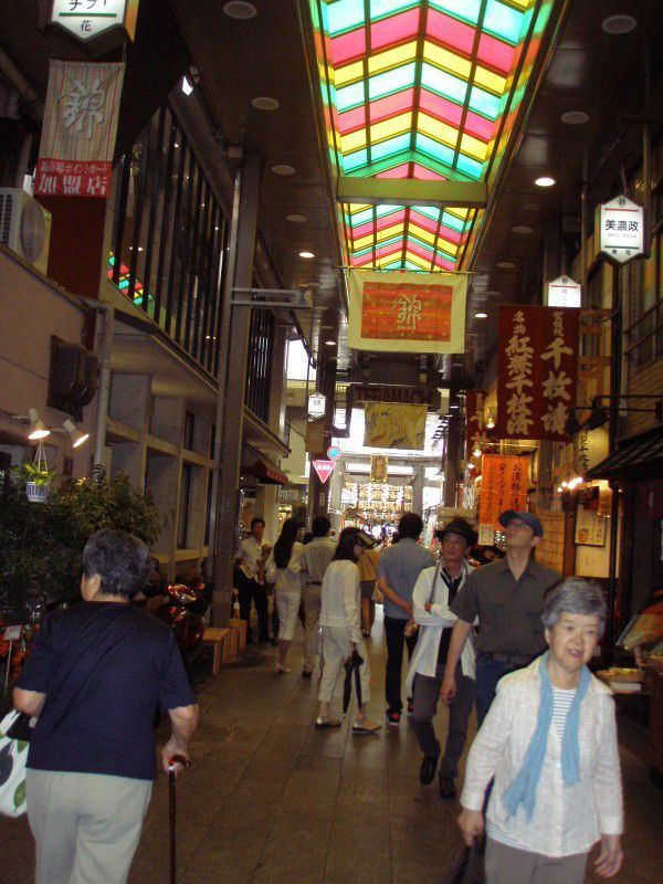 This is Nishiki market, the kichen of Kyoto. It has a long history. They sell fresh vegetables, (kyou Yasai) ,fresh sea food and tofu, traditional handicrafts and so on. This narrow street is 400 m and always crowded with people, who want to buy delicious food and toos in high quality.