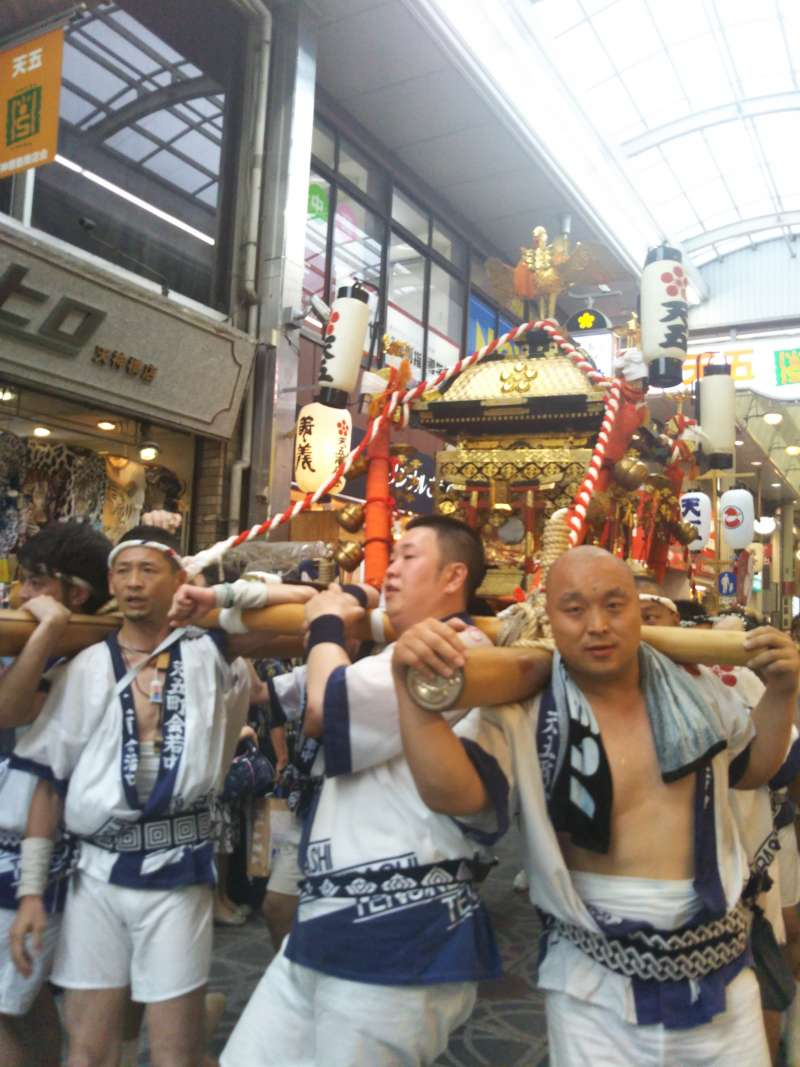 During Tenjin Matsuri Festival, local men and women carry a portable shrine up and down this shopping arcade.