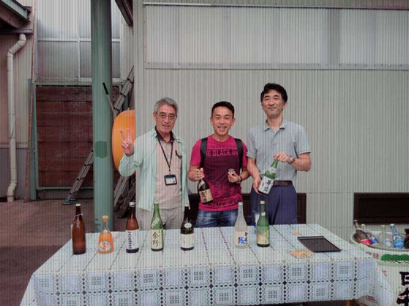 Scene of Sake tasting together with a Singaporean at Kanai Sake Brewery located in Hadaono city near Yokohama. The brewery uses music of Brahms in the process of Sake brewing. Sake there is very much tasty.