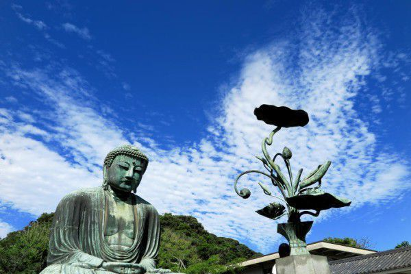 Great Buddha under the blue blue sky with snow-white clouds
