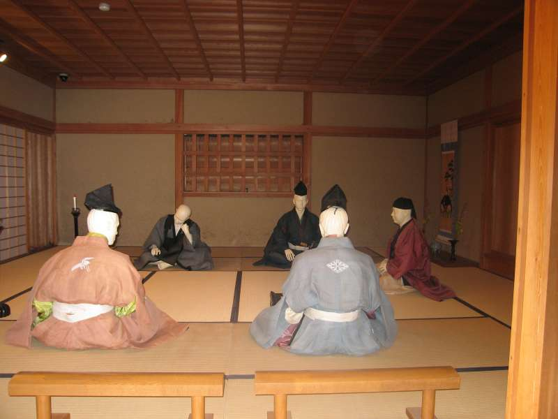 A house depicting a samurai residence in the 16th century. People are enjoying composing