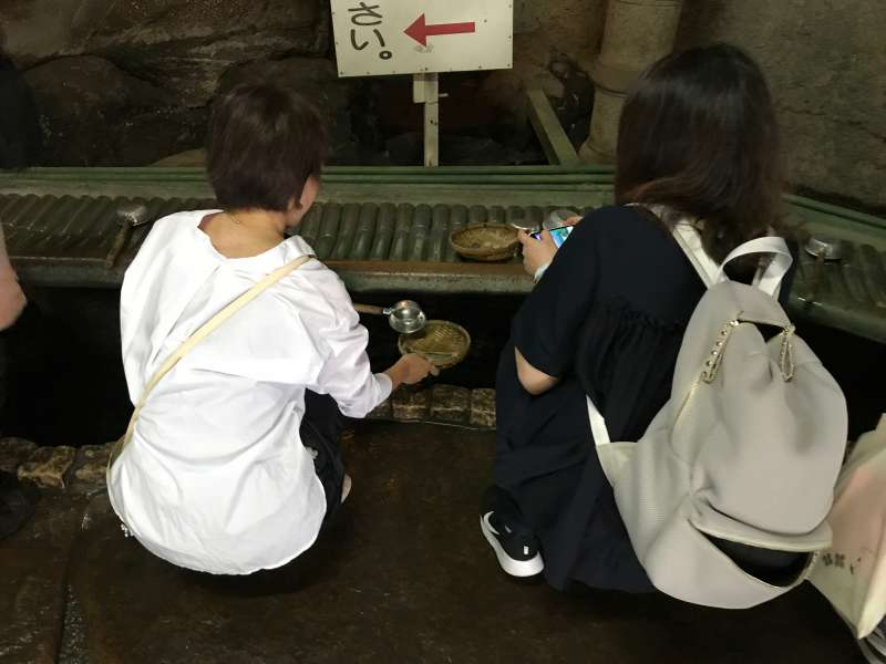 People believe the spring water at the Money Washing Shrine (W3) will energize and multiply it.