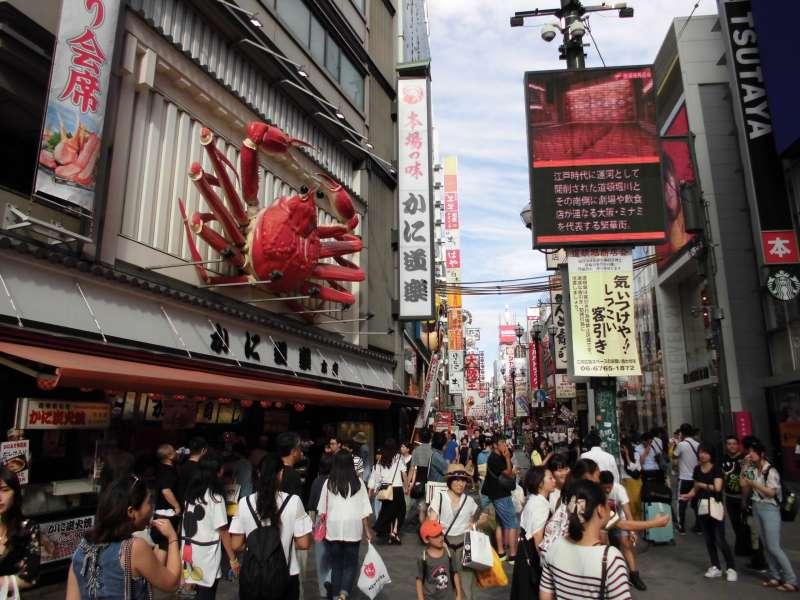 Dotonbori street with billboard of Crab, Kamidoraku.