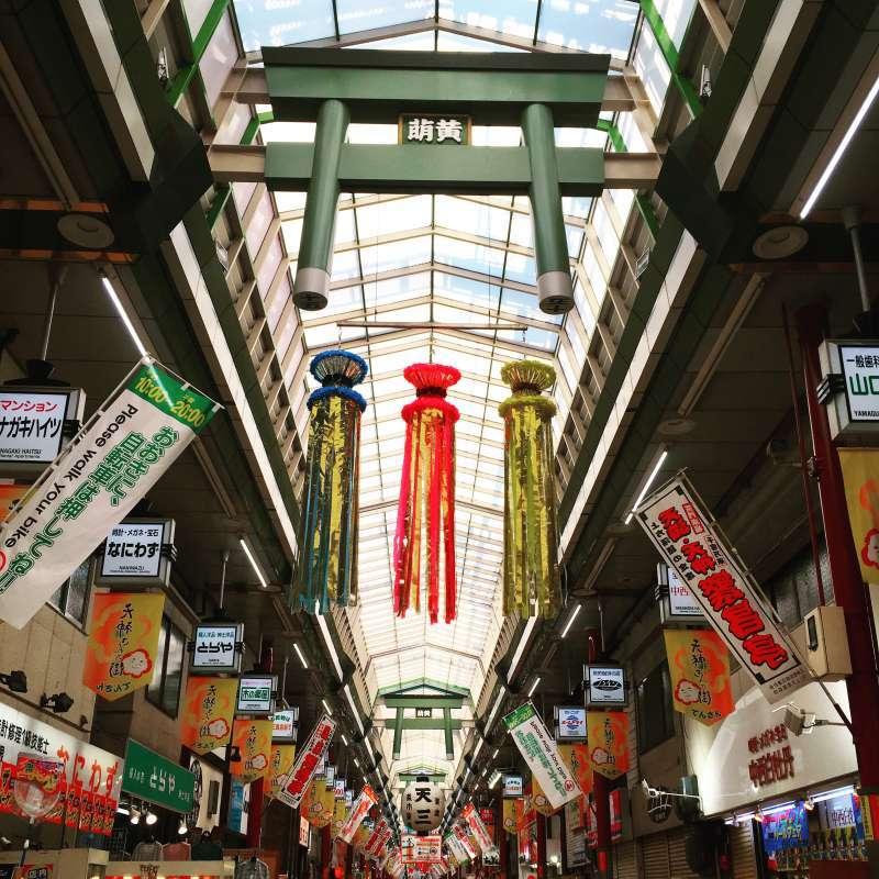 Walking along the longest shopping street,  Tenjinbashisuji, filled with local atmosphere.
