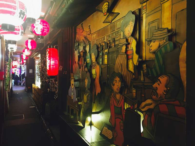 A small alley in Dotombori with late 19th - early 20th century exhibition.