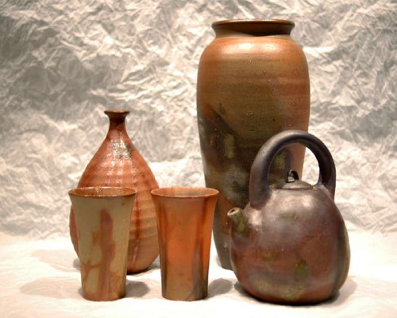 A vase, a cup, a sake bottle, a small sake cup acquire various subdued colors due to pine wood firing at 1250°C .