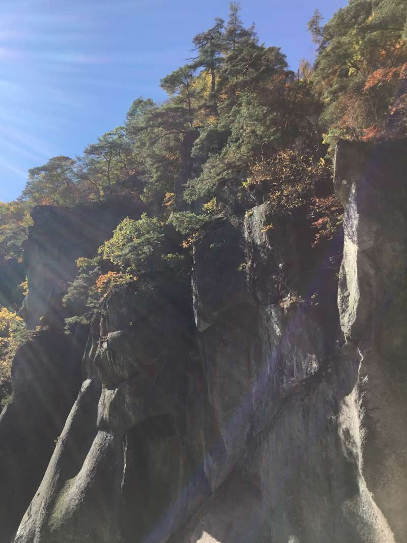 Curious rock called Hannya mask rock (female demon's mask) on the side of the valley