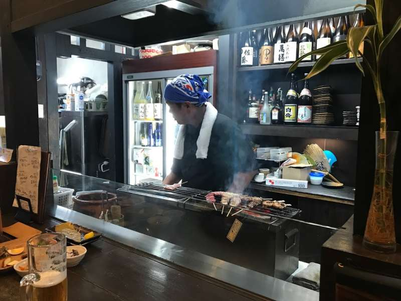 After long walking, a delicious Yakitori, bamboo-skewed chicken grilled by charcoal fire are good for your empty stomach with sweet sake.