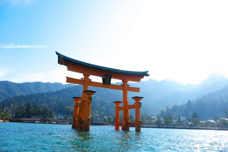 The centuries-old Itsukushima Shrine on Miyajima. The shrine and its torii gate are unique for being built over water, seemingly floating in the sea during high tide. It is outside Hiroshima city.