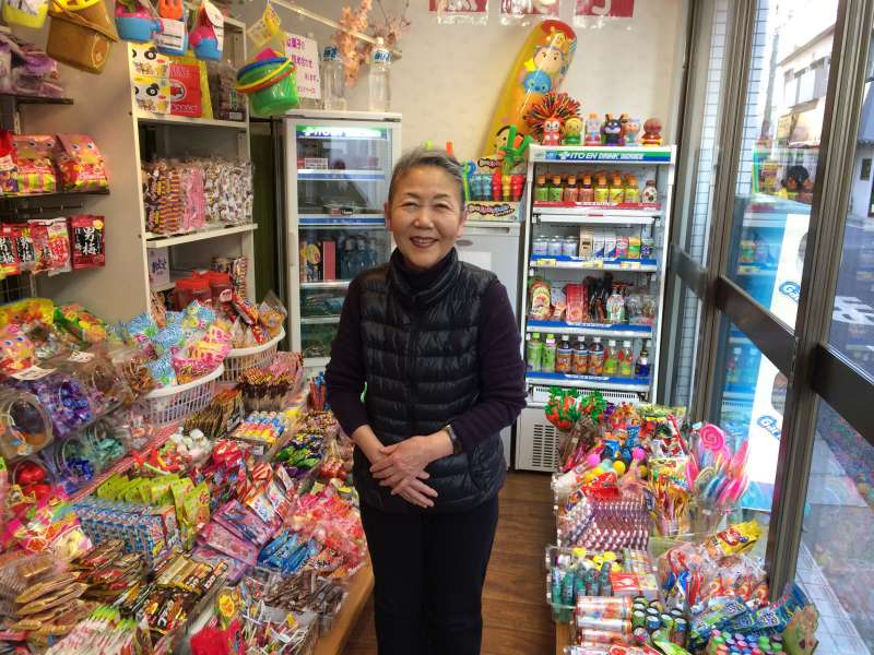 Very friendly shopkeeper of a sweet/snack shop.