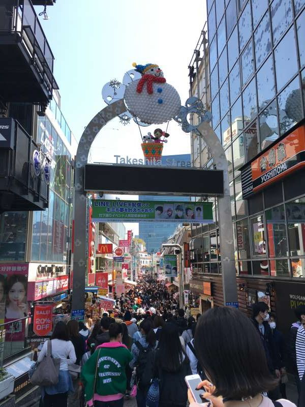 The entrance of Takeshita-dori shopping street which is very popular among the young people.
