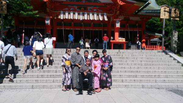In front of 'Honden',the main hall of Fushimi-inari Shrine. Papa and Mama with their children and a very cute grandchild.