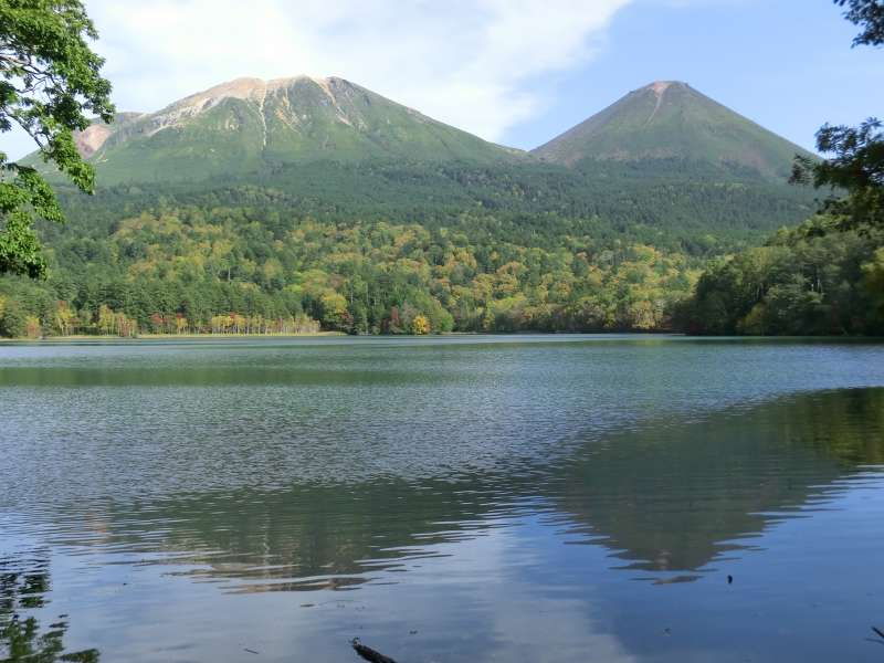Two mountains, Mt. Meakan (left) and Mt. Akan-fuji (right) are so beautiful to be reflected on the water of Lake Onneto.
