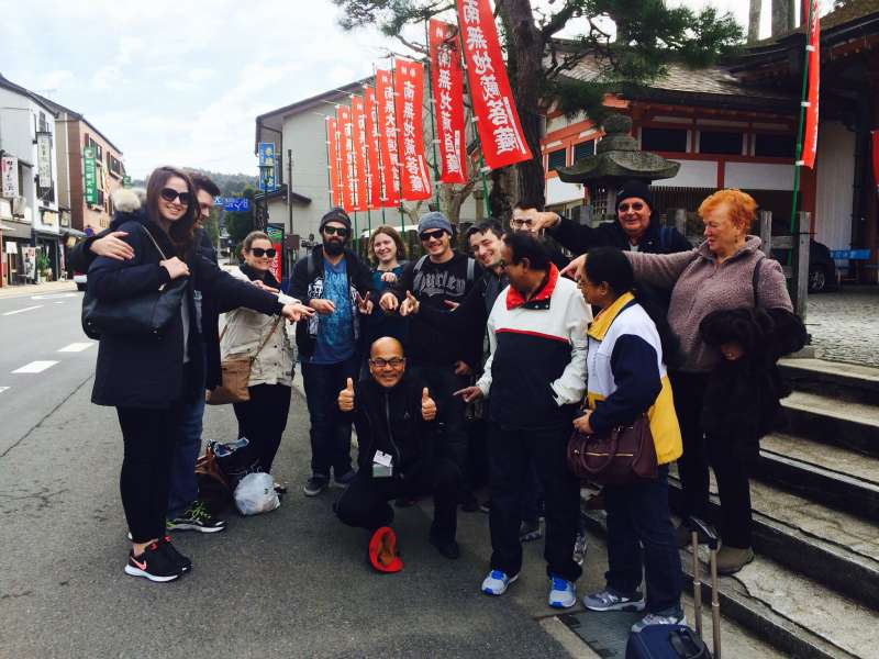 travelers from various countries with Yuji