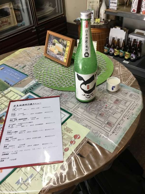 A cup tasting of unrefined sake(called Doburoku)  with JPY100 at the retail shop. More than 10 kinds of cup tasting are possible with JPY100-JPY300 per a cup.