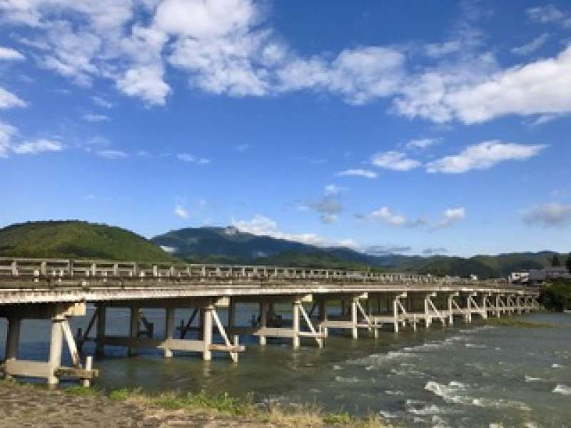 """The Togetsukyō is a bridge across the river. """"Moon crossing"""" stems from lore that when Emperor Kameyama,  during the Kamakura period (1185 to 1333), went boating on the river under a full moon, he said the moon looked like crossing the bridge."""