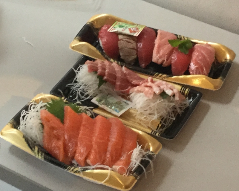 You can buy sashimi (raw fish) and taste on the third floor.
