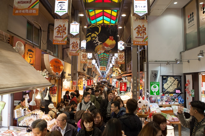 Nishiki Food Market lined with many food shops and many others.