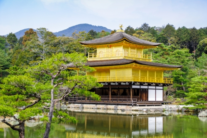 Kinkaku-ji Temple (Golden Pavilion) is a Zen temple in northern Kyoto whose top two floors are completely covered in gold leaf