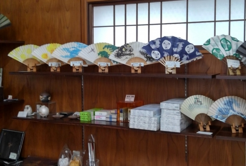 There are so many beautiful handmade folding fans in the shop.