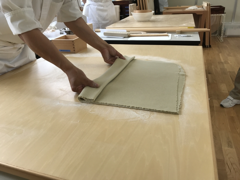 Fold buckwheat dough. In between dough face, spread buckwheat flour not to attach each surface.