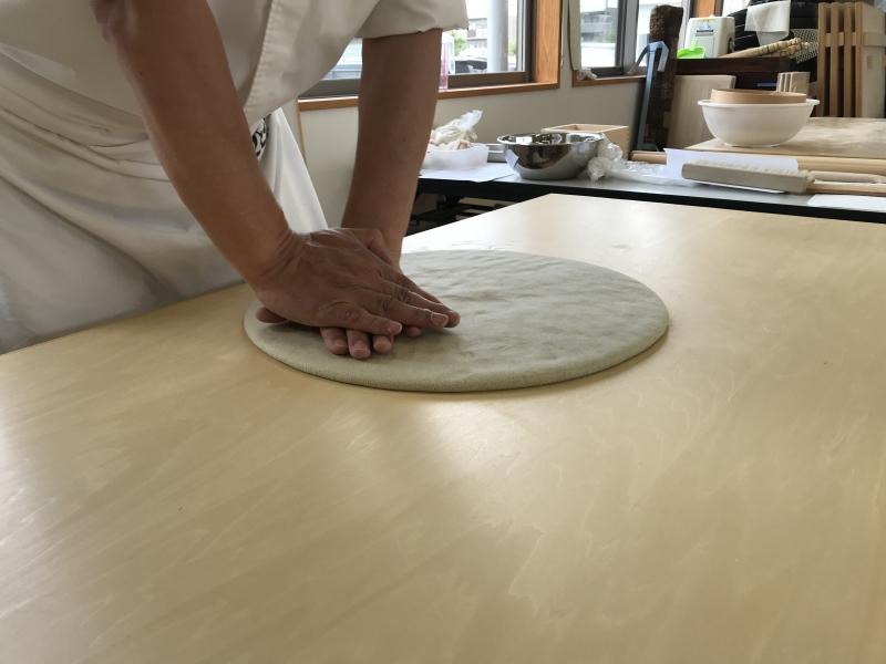 Buckwheat dough is ready. Knead a buckwheats dough. Extend buckwheat dough with your hand.