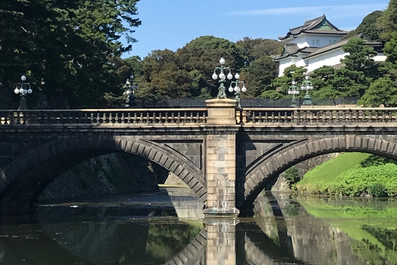 A moat in the Imperial Palace grounds with a samurai castle in the background (#3)