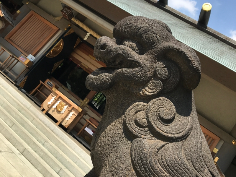 Stone lion dog statue in front of a Shinto Shrine (#2)