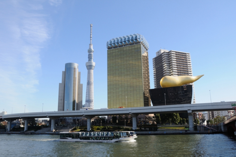Tokyo Sky Tree and a cruise boat on River Sumida