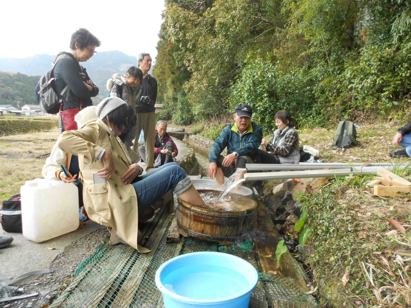 Foot bathing ( Ashiyu) at a local hot spring in the rice field.
