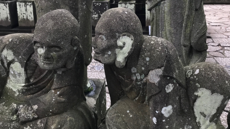 A few of the 540 Buddhist stone statues on the temple grounds. Each has a different facial expression. (#2)