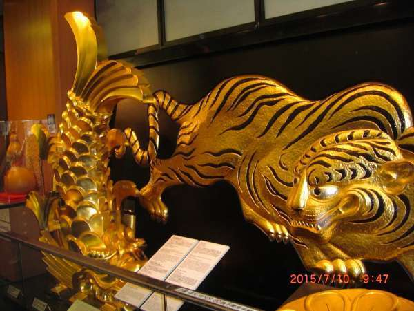 Golden dolphine-like and tiger guardians welcome you